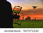 silhouette of man using drone... | Shutterstock . vector #547271242
