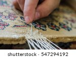 repairing damaged old rug | Shutterstock . vector #547294192