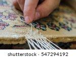 repairing damaged old rug | Shutterstock . vector #547294192