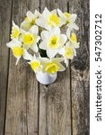 white daffodils at china vase... | Shutterstock . vector #547302712