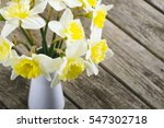 white daffodils at china vase... | Shutterstock . vector #547302718