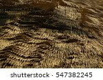 Dried leaves bushels wheat stacked up along streets of Asian fishing village China Thai southeast rural suburb