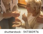 doctor giving medicines to... | Shutterstock . vector #547383976