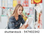 young woman doing grocery... | Shutterstock . vector #547402342