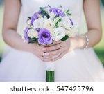The Bride Holding Bouquet...