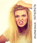 Small photo of Emotions, face expression concept. Furiously mad angry blonde woman holding her hair. Studio shot on white background