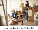 young couple in new apartment... | Shutterstock . vector #547444582