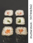 sushi close up on black surface | Shutterstock . vector #547446562