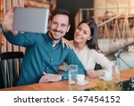 happy couple sitting in the... | Shutterstock . vector #547454152