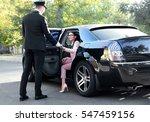 chauffeur opening car door for... | Shutterstock . vector #547459156