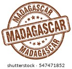 madagascar. stamp. brown round...