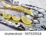 raw mackerel in foil close up.... | Shutterstock . vector #547525018