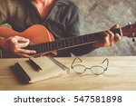young man composing the song... | Shutterstock . vector #547581898