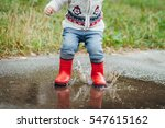 little boy in raincoat and... | Shutterstock . vector #547615162