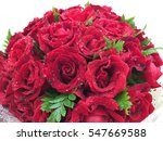 Stock photo red roses bouquet on white background and few green leafs for valentine romantic gift 547669588