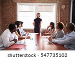 young businesswoman addressing... | Shutterstock . vector #547735102