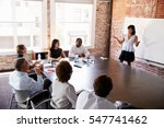 businesswoman at whiteboard... | Shutterstock . vector #547741462