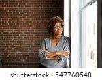 mature businesswoman standing... | Shutterstock . vector #547760548