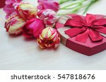 bouquet of tulips and gift box...   Shutterstock . vector #547818676
