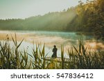 man meditating by the lake | Shutterstock . vector #547836412