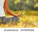 Stock photo young woman practicing morning meditation in nature at the park health lifestyle concept 547849606