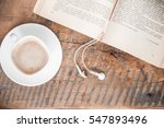 book  headphones and cup of...