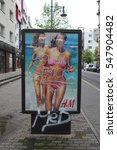 Small photo of Poster of a fashion store with graffiti all over it, claiming the advert is sexist.