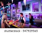 waiter serving cocktail in... | Shutterstock . vector #547929565