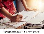 businessman holding paperwork... | Shutterstock . vector #547941976