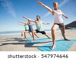 people doing yoga on the beach...   Shutterstock . vector #547974646