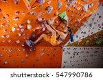 young woman bouldering in... | Shutterstock . vector #547990786