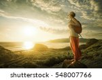 traveller looking at sunset on... | Shutterstock . vector #548007766