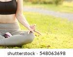 slim women doing yoga in the... | Shutterstock . vector #548063698