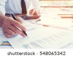 businessmen use the calculator... | Shutterstock . vector #548065342