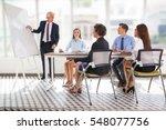 serious senior businessman... | Shutterstock . vector #548077756