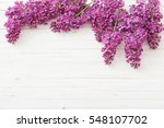 the beautiful lilac on a wooden ... | Shutterstock . vector #548107702