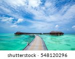 beach with water bungalows at... | Shutterstock . vector #548120296