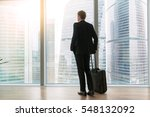 young businessman with suitcase ... | Shutterstock . vector #548132092
