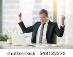Small photo of Young happy businessman with really impressive achievements, victory dance, fast growing company, rewarded, won a good contract, successful deal, positive news on stock, screaming with happiness