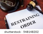 restraining order and gavel on... | Shutterstock . vector #548148202