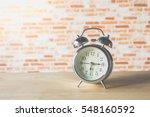 Retro Alarm Clock On Table On...