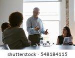 group of businesspeople meeting ... | Shutterstock . vector #548184115