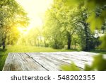 wooden table in garden of... | Shutterstock . vector #548202355