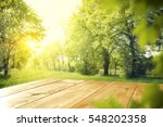 wooden table in garden of... | Shutterstock . vector #548202358