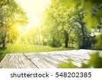 wooden table in garden of... | Shutterstock . vector #548202385