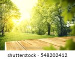 wooden table in garden of... | Shutterstock . vector #548202412