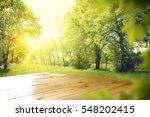 wooden table in garden of... | Shutterstock . vector #548202415