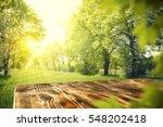 wooden table in garden of... | Shutterstock . vector #548202418