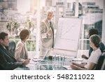 serious businessman giving a... | Shutterstock . vector #548211022