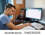 teenager boy doing homework on... | Shutterstock . vector #548250205
